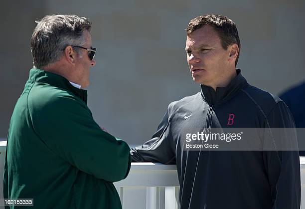 Boston Red Sox general manager Ben Cherington right talks to Red Sox pitcher Alfredo Aceves' agent Tom O'Connell after practice during spring...