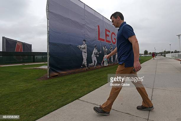 Boston Red Sox general manager Ben Cherington walks to the training fields in the morning