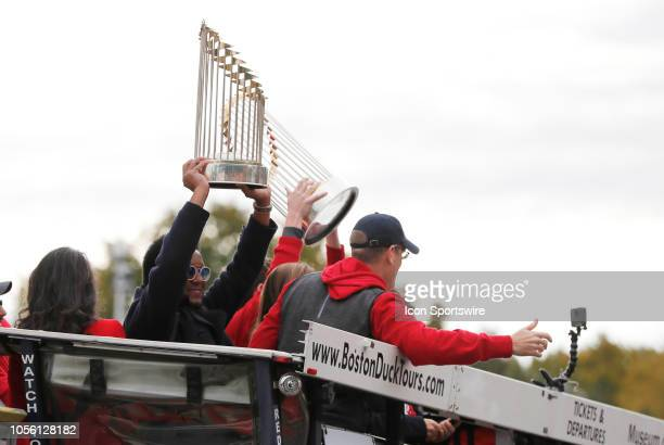 Boston Red Sox great Pedro Martinez displays a trophy during the Boston Red Sox World Series Victory Parade on October 31, 2018 through the streets...