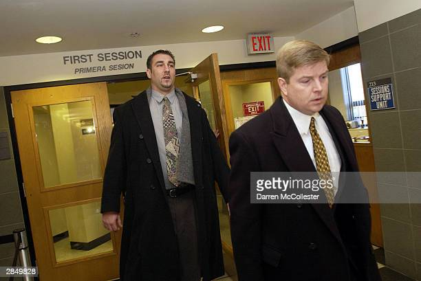 Boston Red Sox groundskeeper Paul Williams is led from court by his attorney Tim Kelleher following an arraignment in Roxbury District Court January...