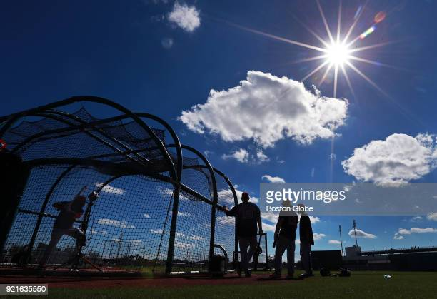 Boston Red Sox hitters work in the batting cage under sunshine and blue skies on the day of the first full squad spring training workout at the...