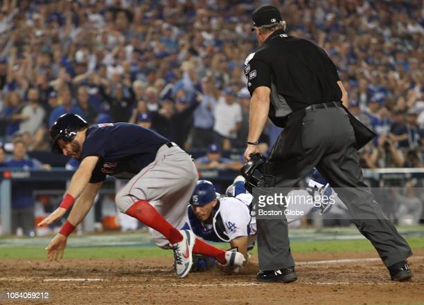 Boston Red Sox Ian Kinsler is tagged out at the plate by catcher Austin Barnes on a throw from Cody Bellinger in the tenth inning in Game 3 of the...
