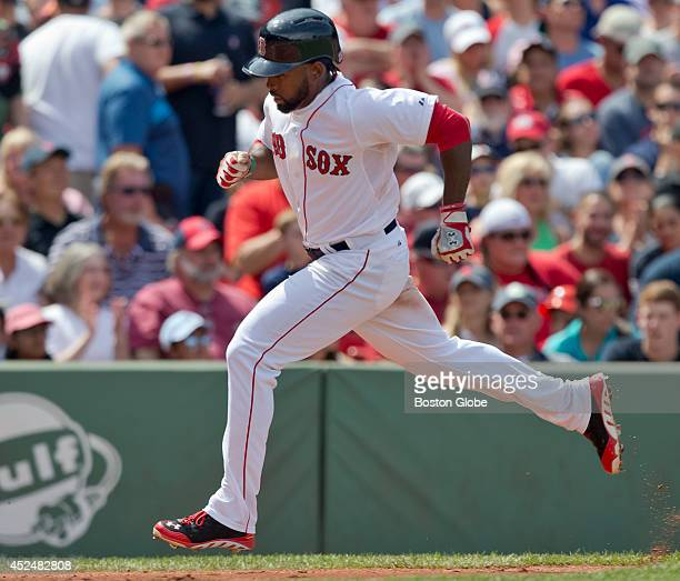 Boston Red Sox Jackie Bradley Jr scores from third base on teammate Daniel Nava's ground rule double against the Kansas City Royals during third...