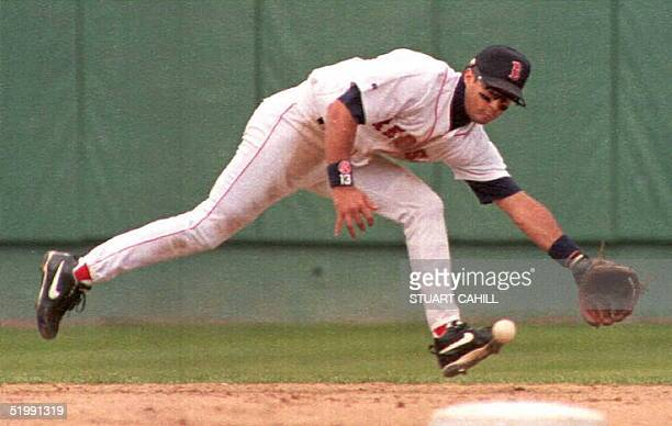 Boston Red Sox John Valentin fields a hit by Toronto Blue Jay Joe Carter during sixth inning action at Fenway Park Boston 23 September The Red Sox...