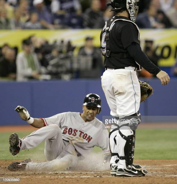 Boston Red Sox Julio Lugo scores the winning run in the ninth inning on Alex Cora's triple to left center field in a 53 victory vs the Toronto Blue...