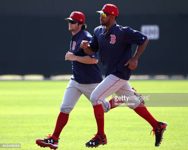 Boston Red Sox left fielder Andrew Benintendi and Boston Red Sox outfielder Chris Young run the bases during a drill on day six of Red Sox Spring...