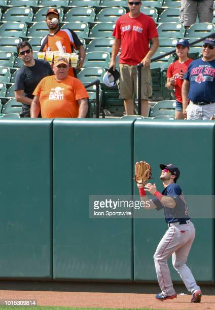 Boston Red Sox left fielder Andrew Benintendi catches a fly ball on the warning track during the game between the Boston Red Sox and the Baltimore...