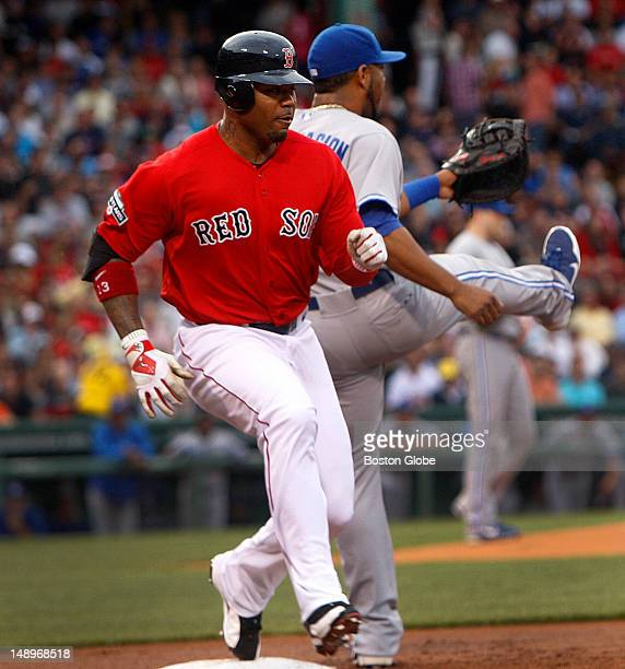 Boston Red Sox left fielder Carl Crawford beats the throw to Toronto Blue Jays designated hitter Edwin Encarnacion for an infield single in the first...