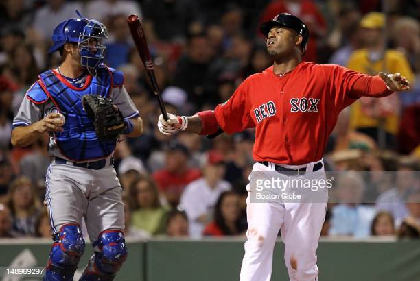 Boston Red Sox left fielder Carl Crawford reacts after striking out swinging in the sixth inning as the Boston Red Sox took on the Toronto Blue Jays...