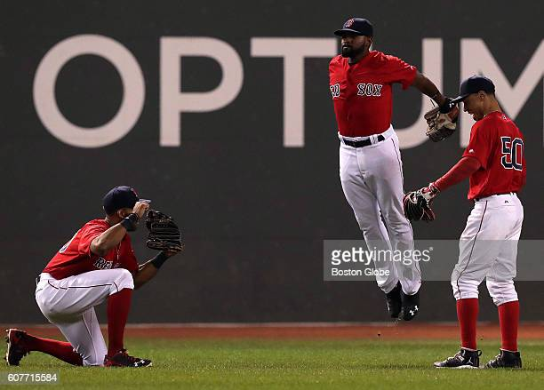 Boston Red Sox left fielder Chris Young Boston Red Sox center fielder Jackie Bradley Jr and Boston Red Sox right fielder Mookie Betts celebrated the...