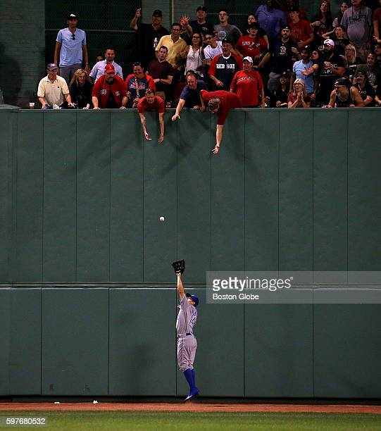 Boston Red Sox left fielder Chris Young hit a long fly to deep center field that had the fans hoping and reaching for a possible home run ball but it...