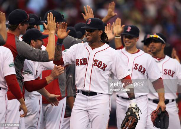 Boston Red Sox left fielder Darnell McDonald and the Boston Red Sox celebrate their win after over the Toronto Blue Jays at Fenway Park.
