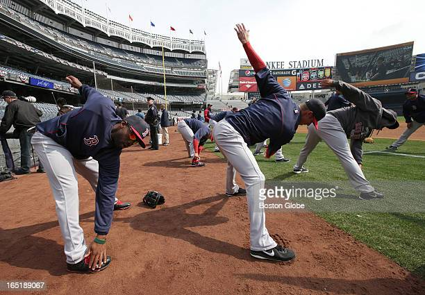 Boston Red Sox left fielder Jackie Bradley at far left foreground loosens up with his teammates before he will play in his first Major League game as...
