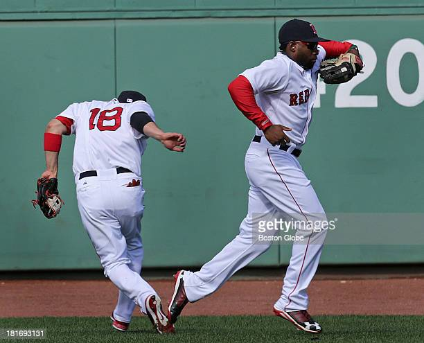 Boston Red Sox left fielder Jackie Bradley Jr makes the catch of a drive to center field by Blue Jays Moises Sierra and avoids a collision with...