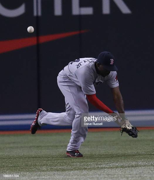 Boston Red Sox left fielder Jackie Bradley Jr. Misplays a J.P. Arencibia hit as the Toronto Blue Jays open a three gem series against the Boston Red...