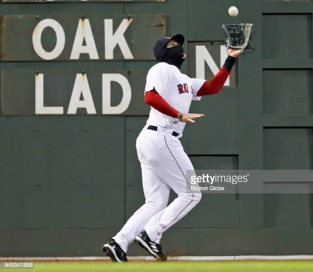 Boston Red Sox left fielder JD Martinez makes the catch on a fourth inning ball hit by the Yankees' Giancarlo Stanton The Boston Red Sox host the New...