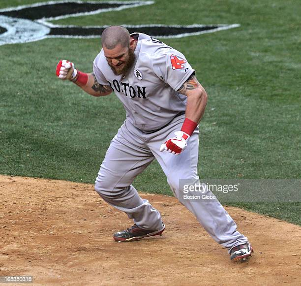 Boston Red Sox left fielder Jonny Gomes was pumped after he scored on an infield single in the ninth inning. The Boston Red Sox play the New York...