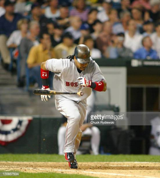 Boston Red Sox Left Fielder Manny Ramirez digustedly throws his bat after flying out during the 2nd game of the ALDS against the Chicago White Sox...