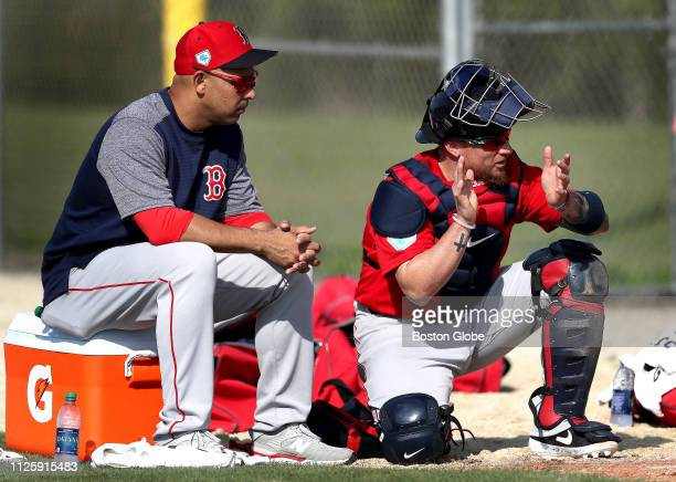 Boston Red Sox manager Alex Cora and Boston Red Sox catcher Christian Vazquez are pictured during a spring training pitchers and catchers workout at...