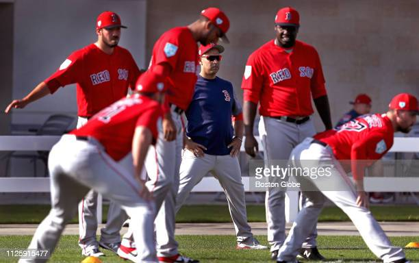 Boston Red Sox manager Alex Cora center looks over his team during a spring training pitchers and catchers workout at JetBlue Park in Fort Myers FL...