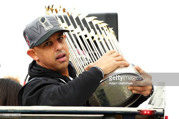 Boston Red Sox Manager Alex Cora holds the World Series trophy during the 2018 World Series victory parade on October 31 2018 in Boston Massachusetts