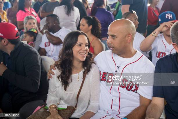 Boston Red Sox manager Alex Cora reacts with his girlfriend Angelica Feliciano during a Boston Red Sox hurricane relief trip from Boston...