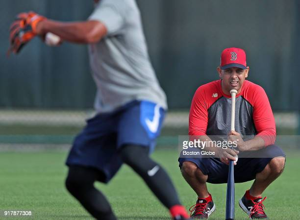 Boston Red Sox manager Alex Cora right watches third baseman TzuWei Lin take ground balls during a spring training workout at the Player Development...