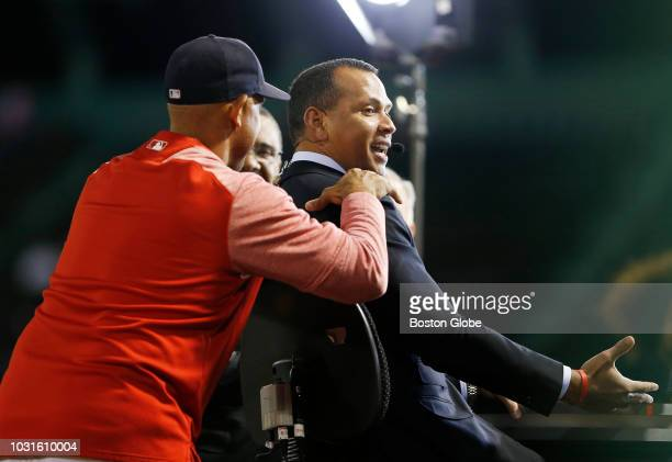 Boston Red Sox manager Alex Cora runs over to say hello to former New York Yankees player Alex Rodriguez who is at Fenway doing commentary for ESPN...