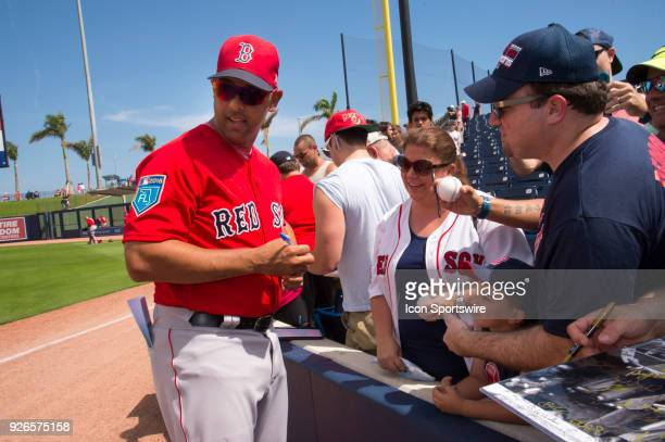 Boston Red Sox Manager Alex Cora signs autographs for fans before the start of an MLB spring training game between the Boston Red Sox and the Houston...