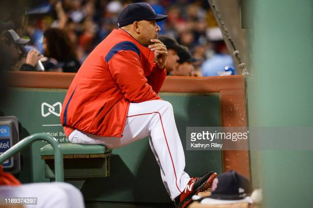 Boston Red Sox Manager Alex Cora sits in the dugout during the fifth inning of the game against the San Francisco Giants at Fenway Park on September...