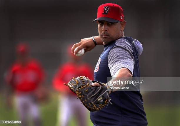 Boston Red Sox manager Alex Cora takes the mound during catchers drills during spring training at JetBlue Park in Fort Myers FL on Feb 20 2019