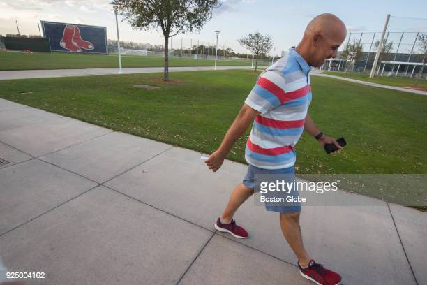 Boston Red Sox manager Alex Cora walks out of JetBlue Park after winning his first major league exhibition game managing the team against the...