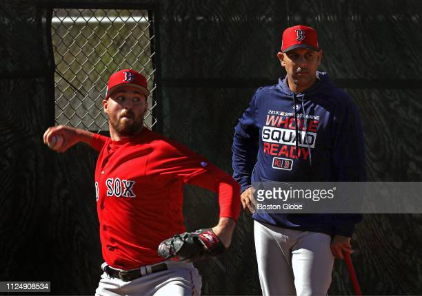 Boston Red Sox manager Alex Cora watches Red Sox pitcher Heath Hembree during a bullpen session at the Boston Red Sox pitchers and catchers workout...