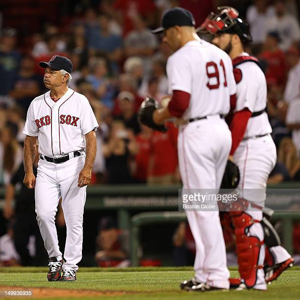 Boston Red Sox manager Bobby Valentine walks to the mound after Boston Red Sox relief pitcher Alfredo Aceves gave back the lead allowing a \three run...