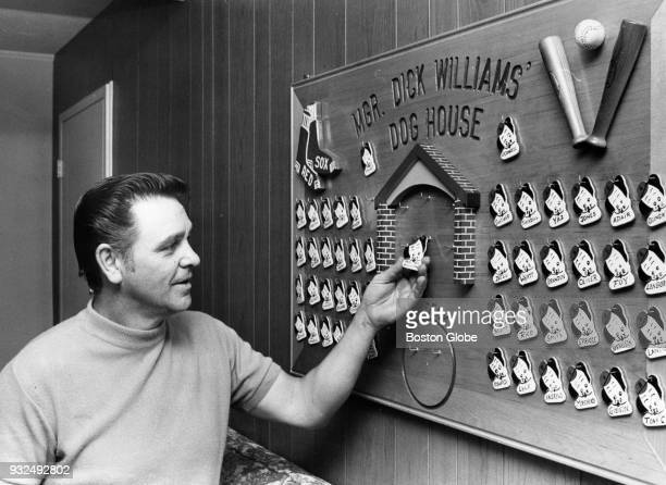 Boston Red Sox manager Dick Williams checks the Dog House at his home in Peabody Mass on Dec 12 1969