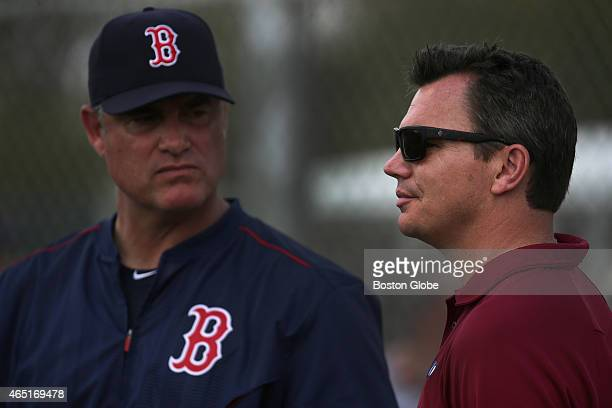 Boston Red Sox Manager John Farrell and Red Sox General Manager Ben Cherington observe the day's workout