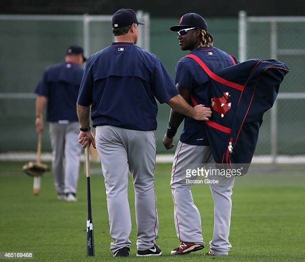 Boston Red Sox manager John Farrell and Red Sox shortstop Hanley Ramirez head for the clubhouse after the day's workout