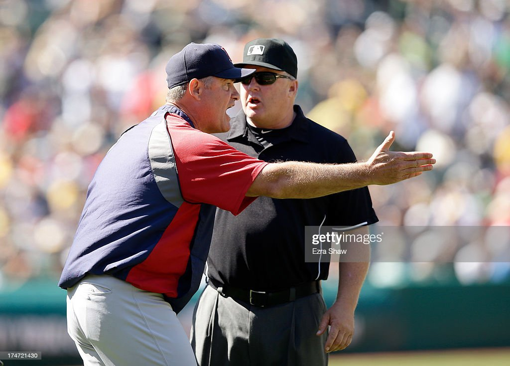 Boston Red Sox manager John Farrell argues with umpire Bill Miller after Gomes struck out in the ninth inning of their game against the Oakland Athletics at O.co Coliseum on July 14, 2013 in Oakland, California.
