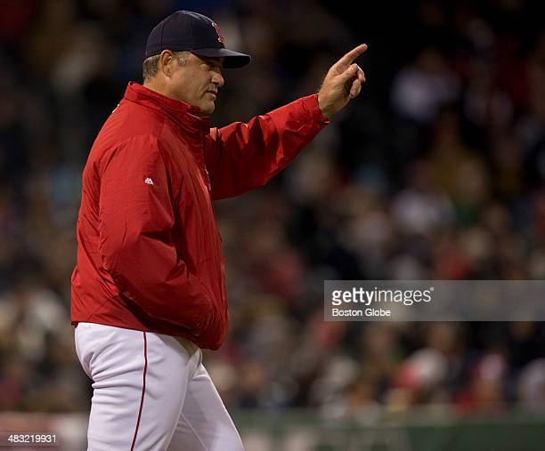 Boston Red Sox manager John Farrell goes for a left hander in the bull pen after starting pitcher Clay Buchholz gave up 13 hits to the Milwaukee...