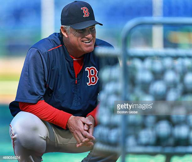 Boston Red Sox manager John Farrell is pictured admiring baseballs that will be used for the new season The Boston Red Sox held a workout at Citizens...