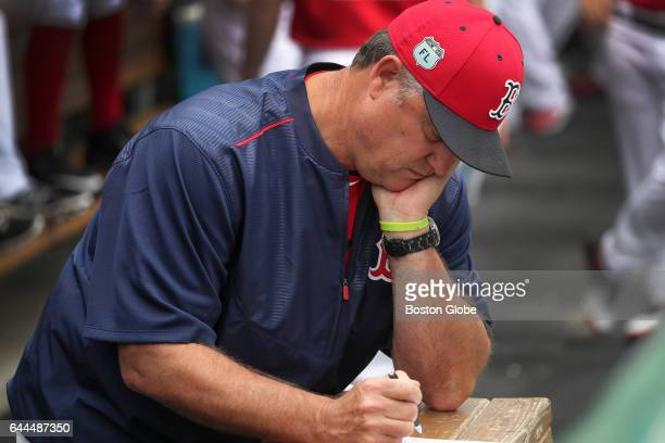 Boston Red Sox manager John Farrell is pictured in the Red Sox dugout before the start of the day's game against Northeastern University on day...