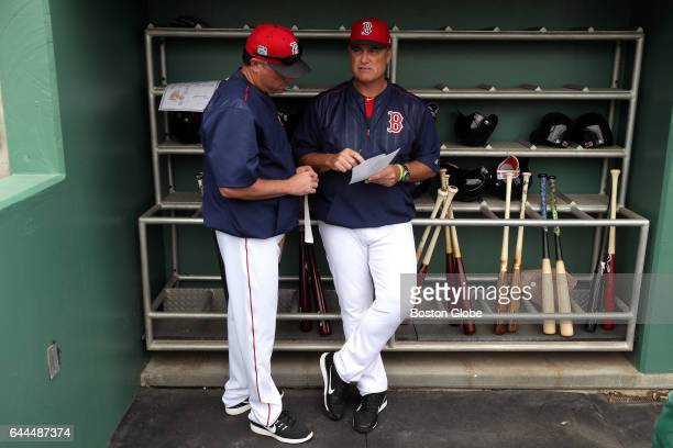 Boston Red Sox manager John Farrell is pictured with Boston Red Sox Bench Coach Gary DiSarcina in the Sox dugout before the start of the day's game...