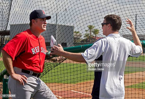 Boston Red Sox manager John Farrell left talks to general manager Ben Cherington Day two of spring training at the Red Sox training facilities at...