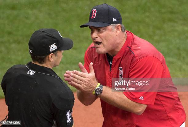 Boston Red Sox manager John Farrell pleads his case after being tossed in the second inning of an elimination loss to the Astros The Boston Red Sox...