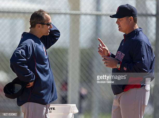 Boston Red Sox manager John Farrell right talks to his bench coach Torey Lovullo during spring training at JetBlue Park on Monday Feb 18 2013