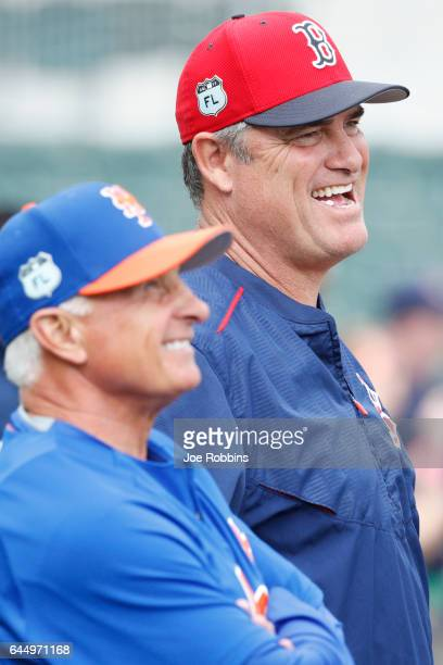 Boston Red Sox manager John Farrell shares a laugh with New York Mets manager Terry Collins before the game at JetBlue Park at Fenway South on...