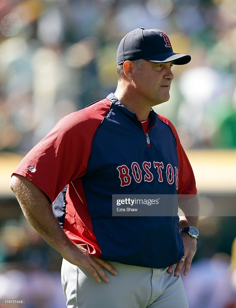 Boston Red Sox manager John Farrell stands on the field during their game against the Oakland Athletics at O.co Coliseum on July 14, 2013 in Oakland, California.