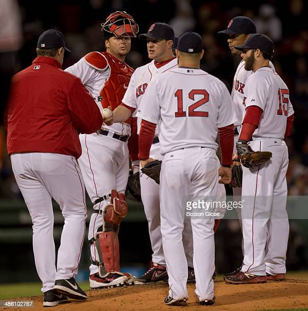 Boston Red Sox manager John Farrell takes out starting pitcher Jake Peavy during sixth inning action at Fenway Park on Sunday April 20 2014