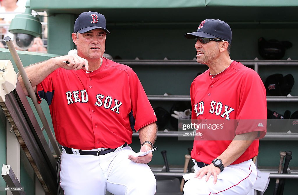 Boston Red Sox Manager John Farrell #53 talks with Bench Coach Torey Lovullo #17 during the game against the St. Louis Cardinals at JetBlue Park on February 26, 2013 in Fort Myers, Florida.