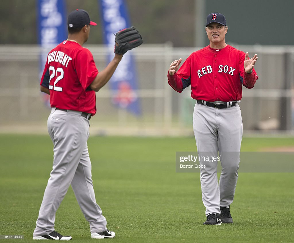 Boston Red Sox manager John Farrell working with pitcher Felix Doubront during a throwing session. Day three of spring training at the Red Sox training facilities at JetBlue Park on Thursday, Feb. 14, 2013.
